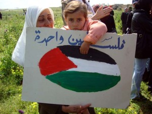 Palestinian_child_holds_a_sign_on_Land_Day